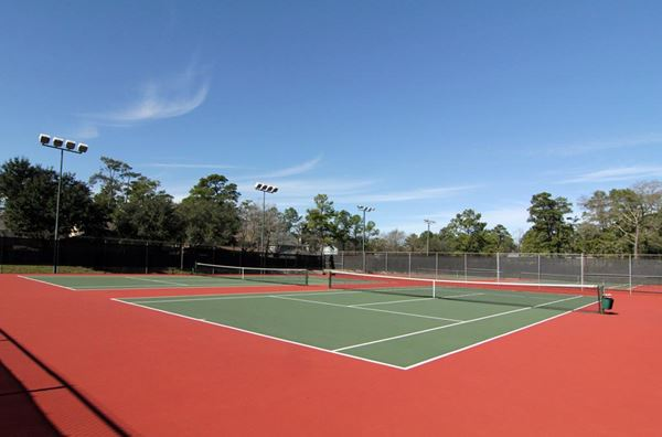 Tennis Club and Lessons: Our East Park includes six high-fenced tennis courts with adjacent covered gazebo and bathrooms.  Another two tennis courts are available at our West Park and are currently undergoing renovations. thumbnail