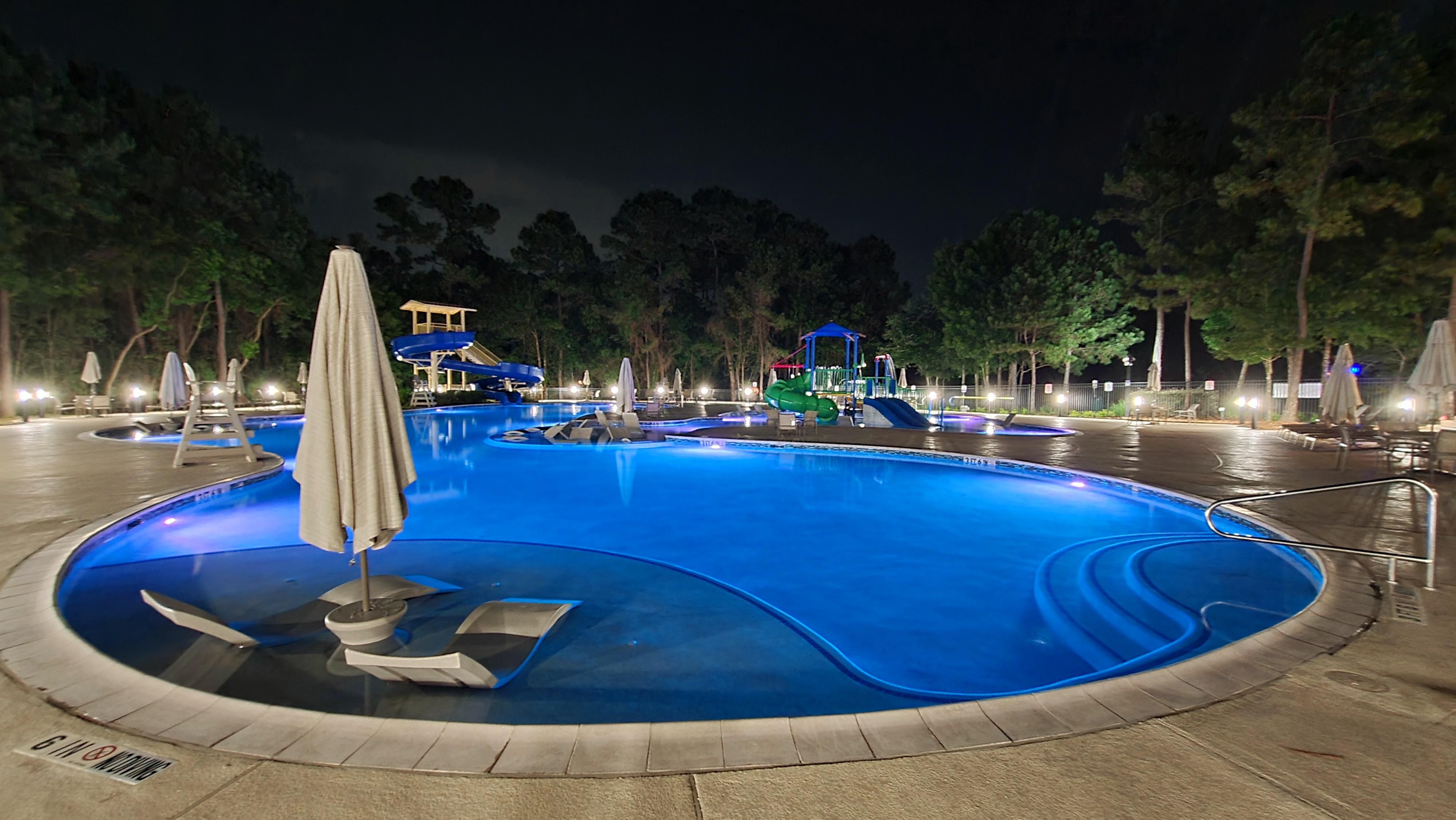 Resort-style pool at night with color changing LED pool lights thumbnail